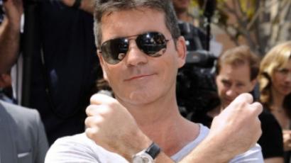 Botrány! Barátja feleségét ejtette teherbe Simon Cowell