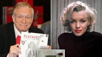 Marilyn Monroe mellé temetik Hugh Hefnert