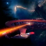 USS Enterprise-D:Galaxy fézerrel tüzel,háttérben pedig csillagköd