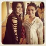 Selena with a fan;).jpg